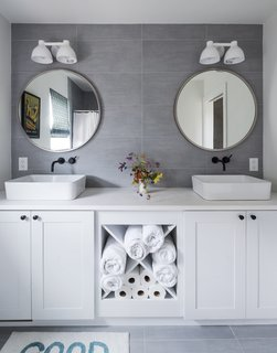 The vanity was installed at the factory, and the mirrors and lights were added on-site.