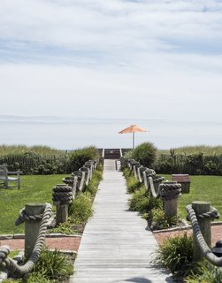 The home is located just steps away from the beach. Montauk Shores boasts approximately 900 feet of waterfront coastline and a tight-knit community.