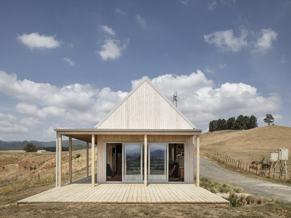 The north side of the home opens up to a covered wraparound deck and views of the Karangahake Gorge.