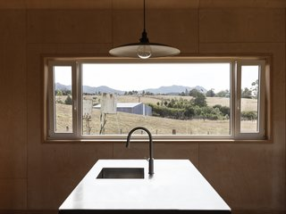 A pair of tilt-and-turn windows flank a fixed window in the kitchen. All glazing is double paned.
