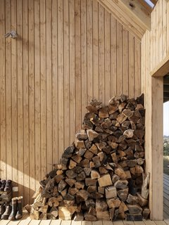 The Outdoor Room stores stacked firewood used for the wood-burning stove in the living room.