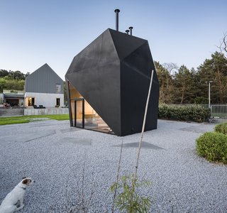 Located in the historic Polish city of Toruń, the simple and clean design of the Origami House complements the contemporary main house.