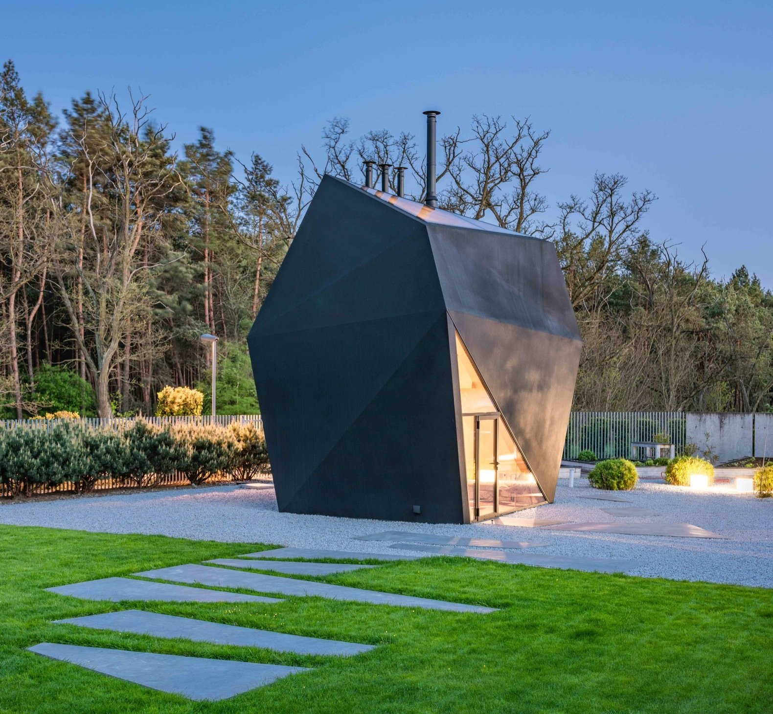 Exterior, Metal Roof Material, Metal Siding Material, and House Building Type Every element and facet of the design was developed with 3D modeling.   Photo 5 of 8 in A Family in Poland Adds an Origami-Inspired Retreat to Their Backyard