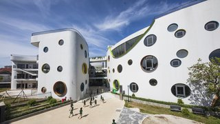 A Vivid, Curvaceous Kindergarten Takes Cues From Feng Shui in Vietnam