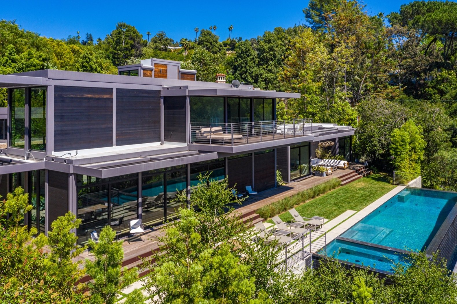 Exterior, House Building Type, Wood Siding Material, Flat RoofLine, and Prefab Building Type The 3,975-square-foot steel-frame house comes with five bedrooms and four-and-a-half baths.   Photo 2 of 15 in Will Arnett Lists His Prefab-Hybrid Home in Beverly Hills for $11M