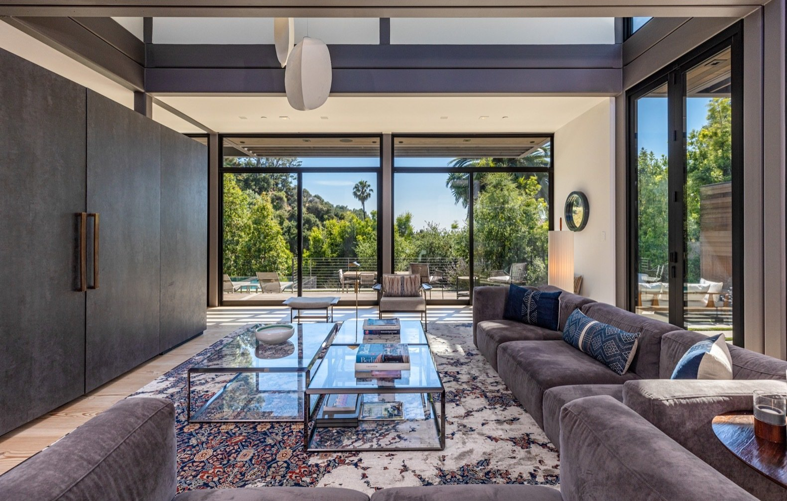 Living Room, Sofa, Accent Lighting, and Light Hardwood Floor Two stacked modules make up the double-height living room.   Photo 13 of 15 in Will Arnett Lists His Prefab-Hybrid Home in Beverly Hills for $11M