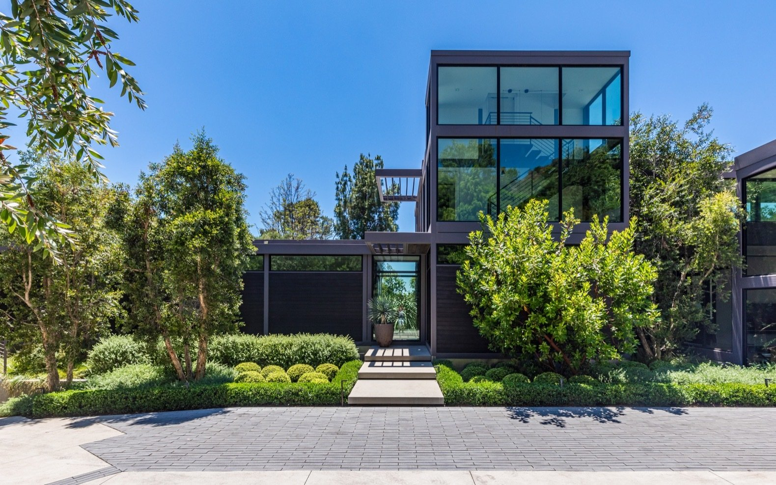 Exterior, House Building Type, Prefab Building Type, Flat RoofLine, and Wood Siding Material A site-built glass tower houses the staircase that leads up to the master suite.   Photo 3 of 15 in Will Arnett Lists His Prefab-Hybrid Home in Beverly Hills for $11M