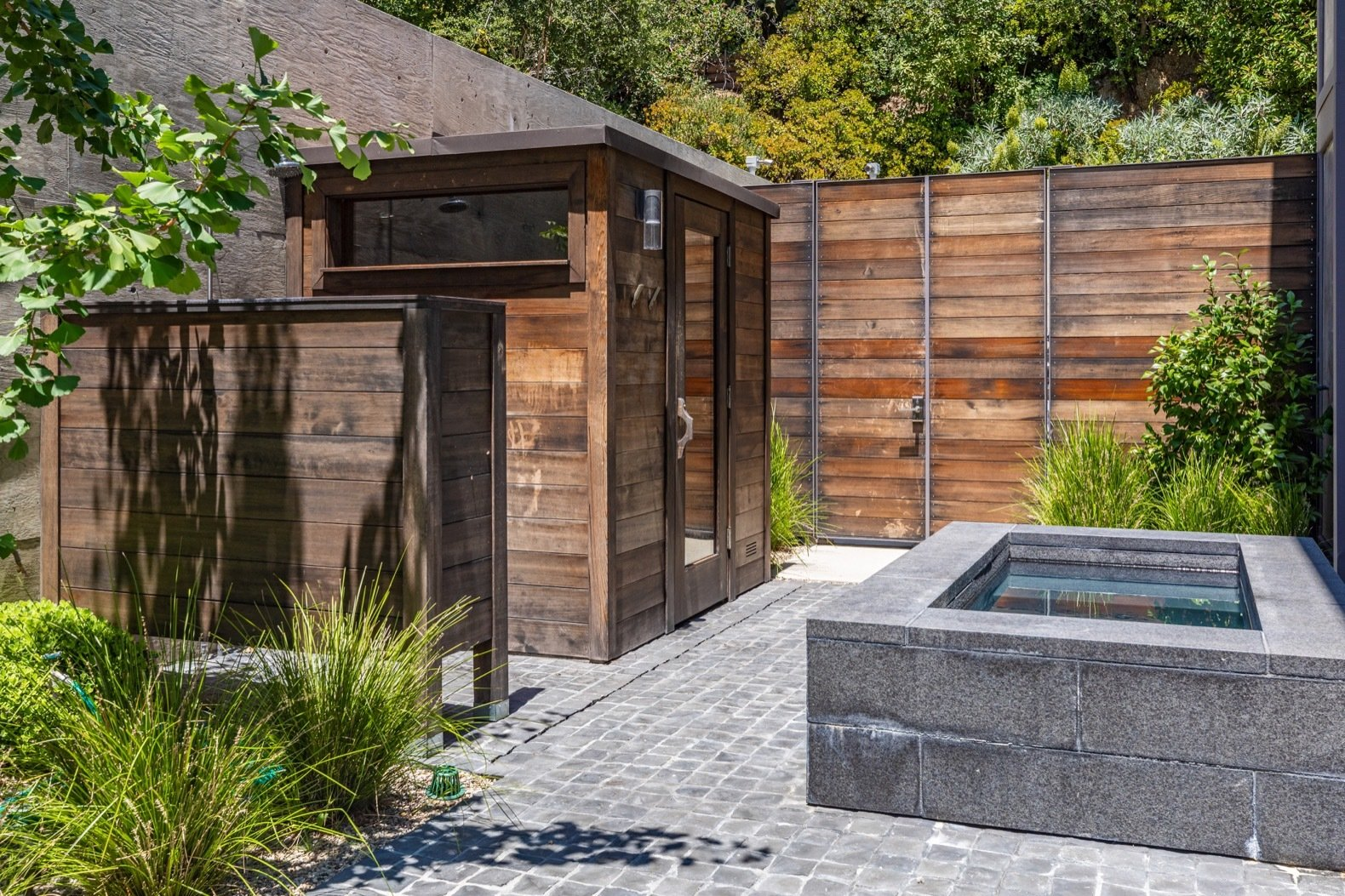 Outdoor, Back Yard, Shrubs, Trees, Wood Fences, Wall, Small Pools, Tubs, Shower, and Hardscapes A spa is tucked into the north side of the site and can be easily accessed from the living room.   Photo 12 of 15 in Will Arnett Lists His Prefab-Hybrid Home in Beverly Hills for $11M