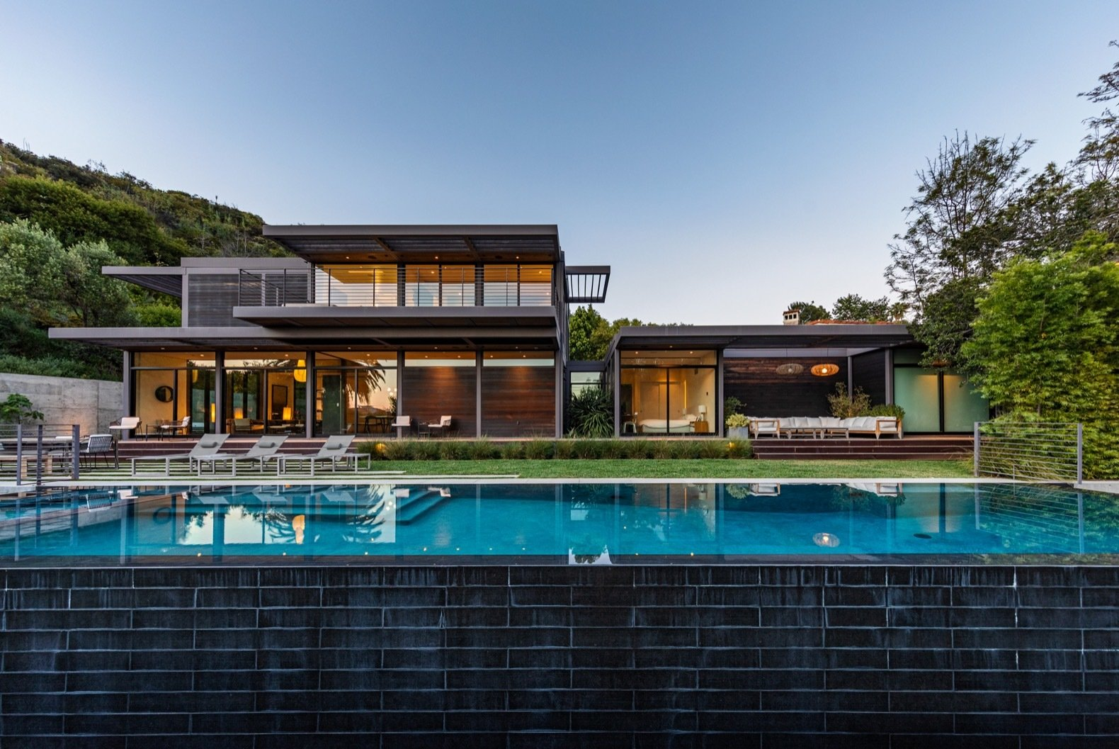 Exterior, Prefab Building Type, Wood Siding Material, House Building Type, and Flat RoofLine The home and backyard face southwest for views of Franklin Canyon.   Photo 8 of 15 in Will Arnett Lists His Prefab-Hybrid Home in Beverly Hills for $11M