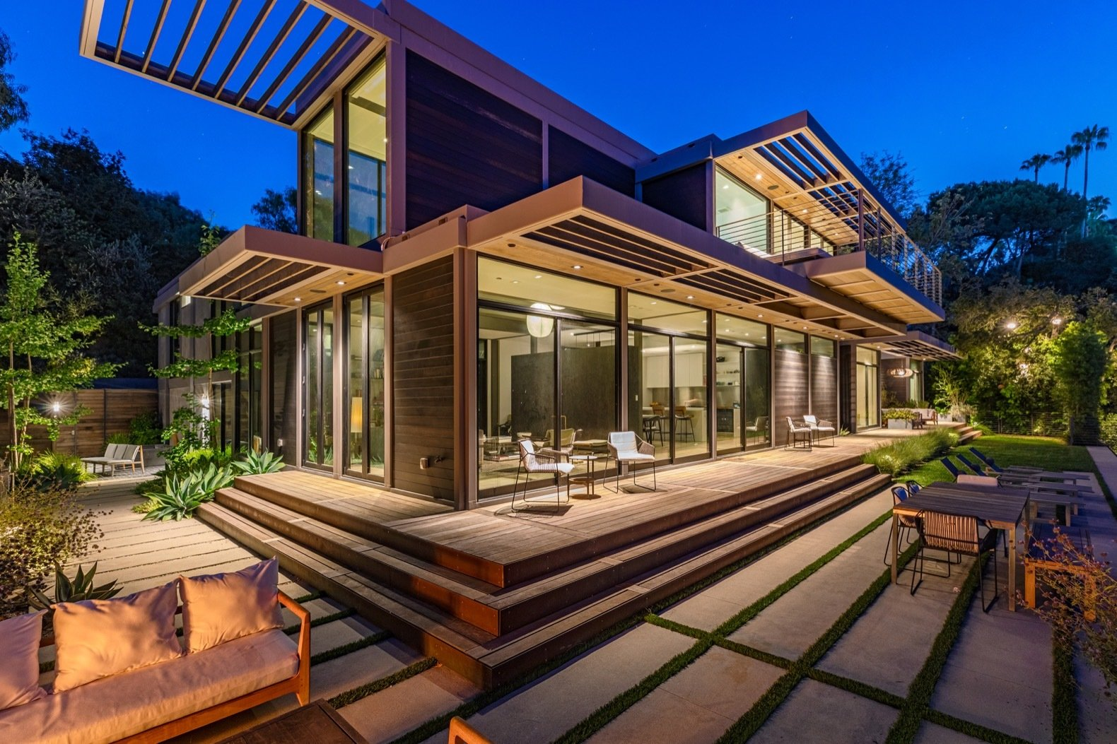 Exterior, Wood Siding Material, House Building Type, Prefab Building Type, and Flat RoofLine Steel-and-wood trellises provide protection from the L.A. sun.   Photo 9 of 15 in Will Arnett Lists His Prefab-Hybrid Home in Beverly Hills for $11M