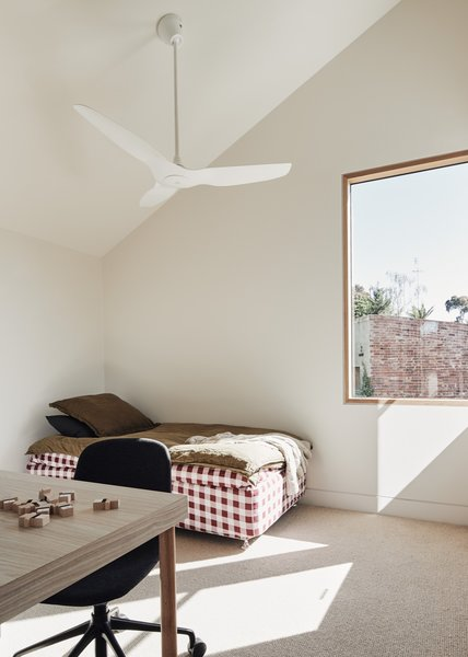 The upper floor of the extension houses two sun-soaked bedrooms.