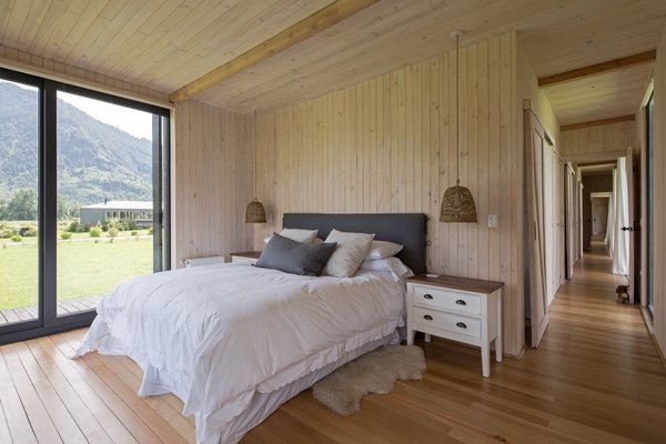 The main bedroom bookends the west side of the home and opens up to the outdoors via glass sliders on two sides.