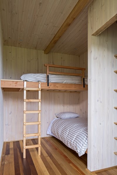 The smallest bedroom in the visitor wing has two bunkbeds, a closet, and a shared bathroom to the side.