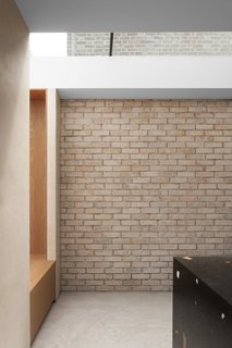 The pale brick wall strengthens the visual connection between indoors and out.