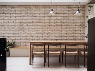 Yellow Cloud Studio designed the dining table that was built by Stuart Indge Ltd. The midcentury chairs are by Arne Hovmand Olsen, made by Mogens Kold.