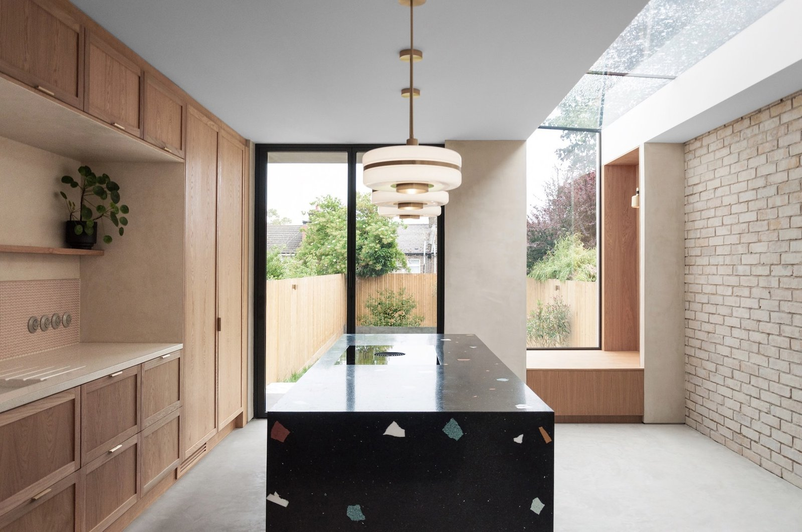 Glyn House by Yellow Cloud Studio kitchen with black terrazzo island