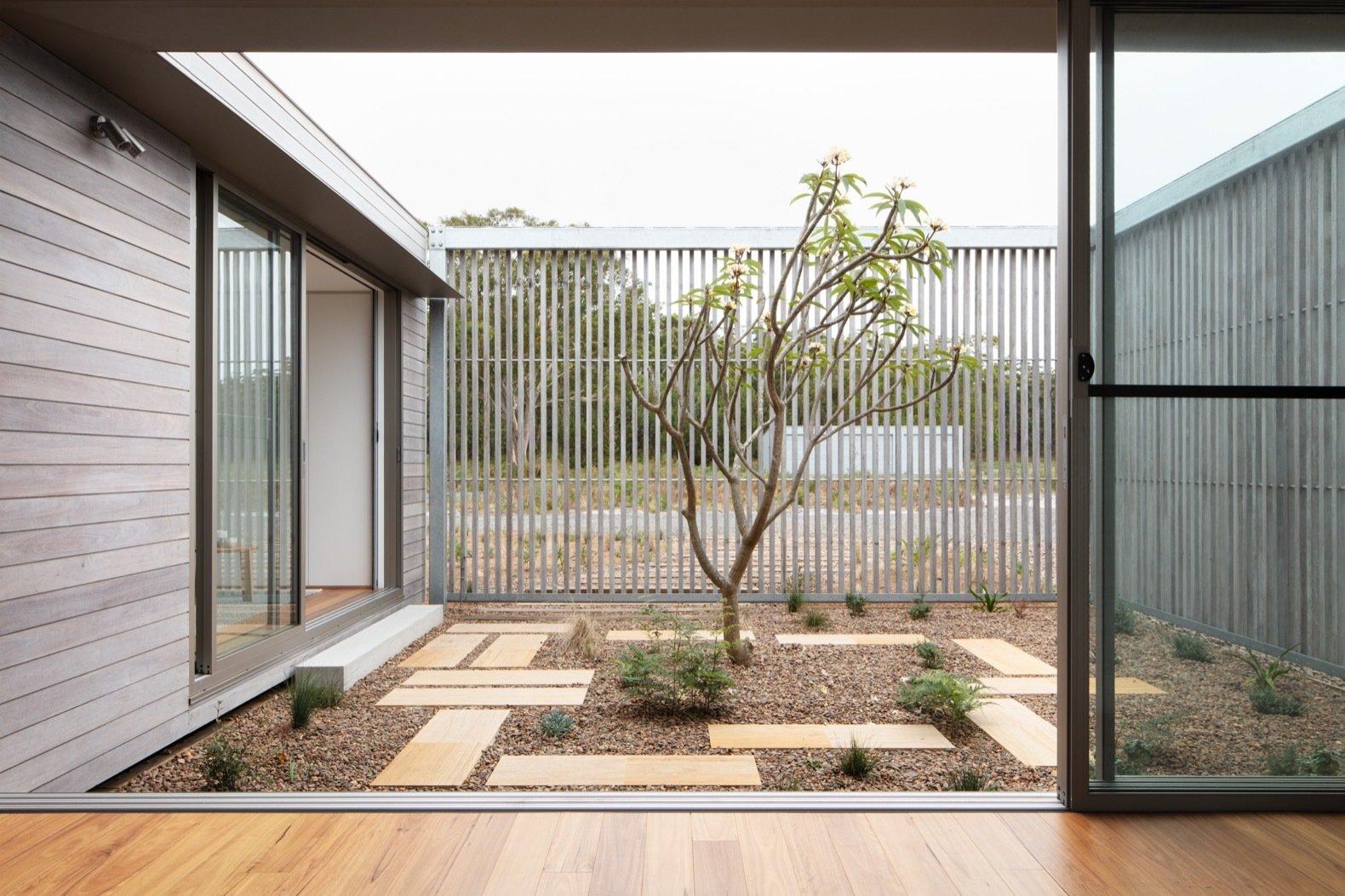 Courtyard of Courtyard House by CHROFI and FABPREFAB