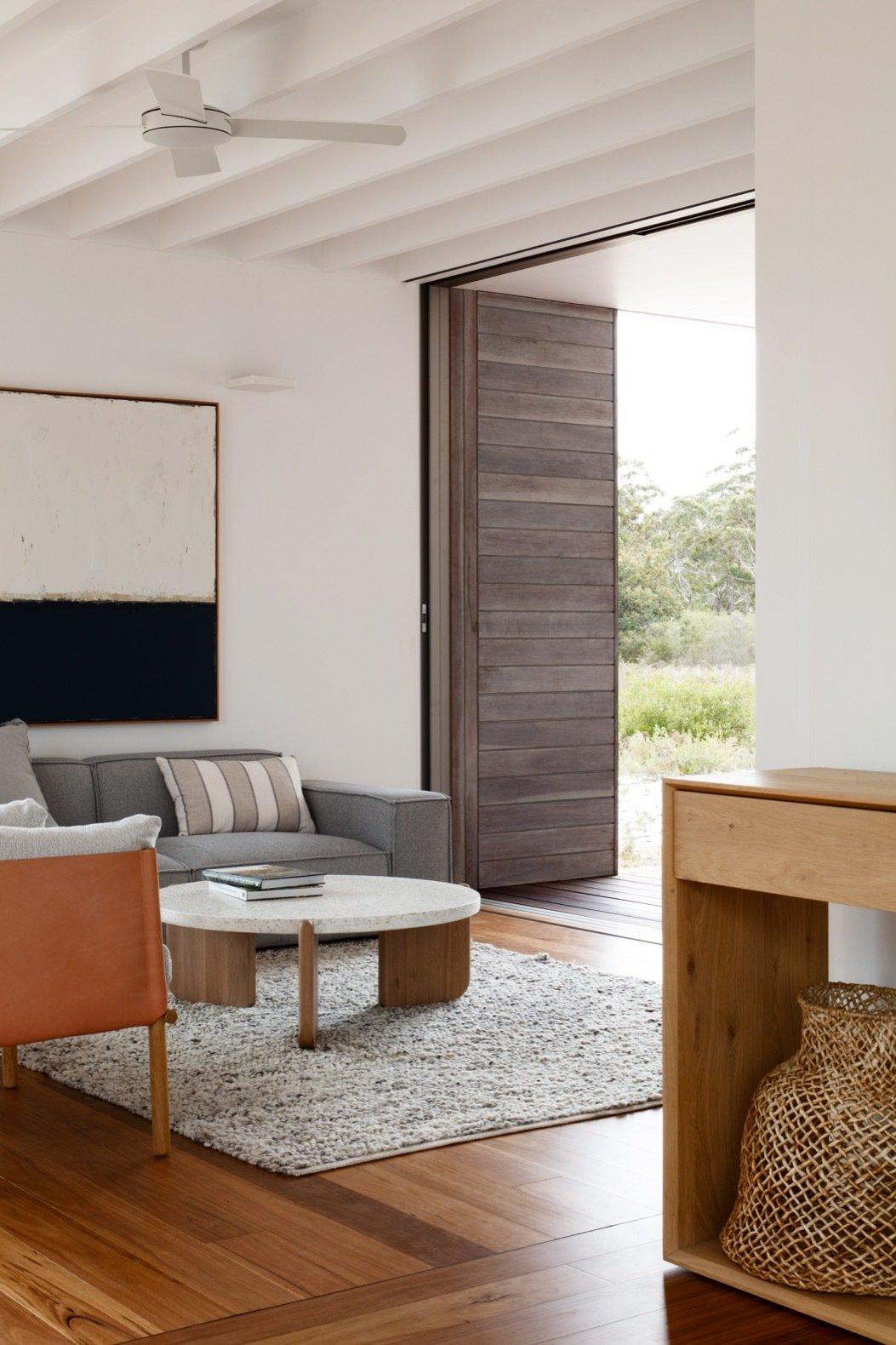 Living area of Courtyard House by CHROFI and FABPREFAB