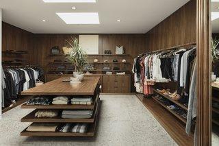 Black walnut surrounds the U-shaped master closet.