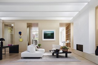 Large-scale sliding doors divide the active zones at the front of the home from the quiet zones in the rear.