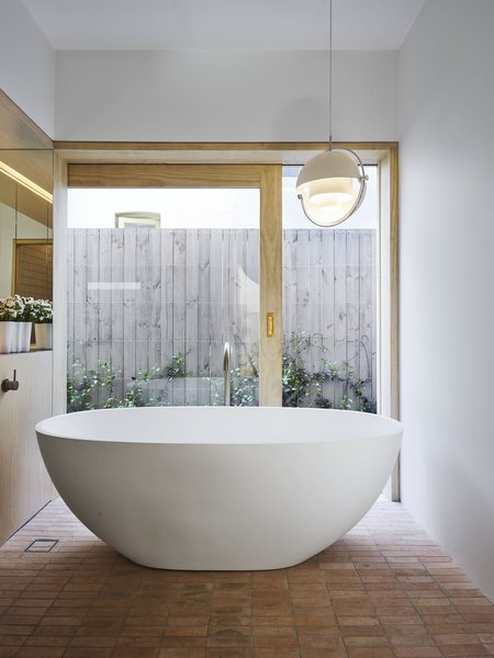 Garden views can be enjoyed throughout the home—including in the bathroom.