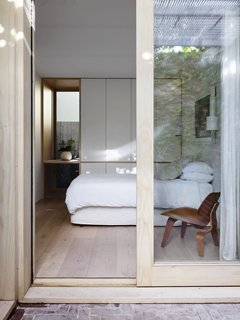 Thoughtful joinery in the guest bedroom includes a low cupboard large enough for suitcases.