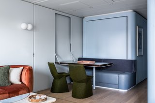 The custom dining table is paired with Mars dining chairs covered in Maharam wool by Konstantin Grcic.