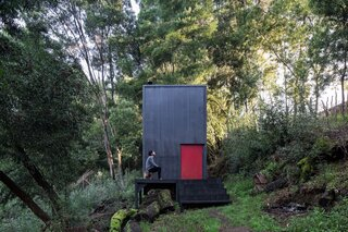 This Matte Black Cabin Was Built for Roughly the Cost of a Standard Sedan