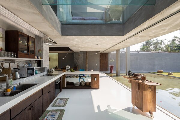 The countertops and cabinetry in the kitchen were constructed on-site from terrazzo and reclaimed wood.
