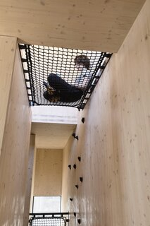 Netting and voids also help fill the home with daylight from above.