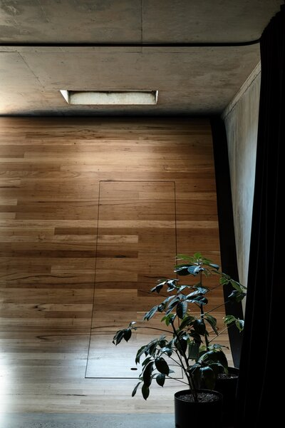 Storage is hidden inside the wooden ramp.