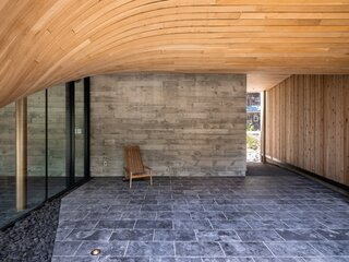 A breezeway to the right of the trough separates the pool pavilion from the guesthouse.