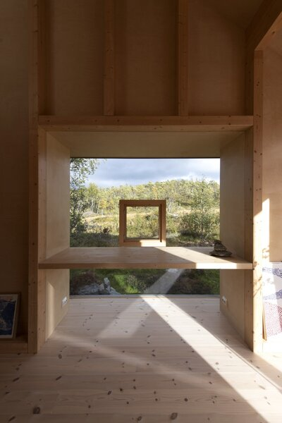 This strategically placed window with an operable opening frames views of the landscape.