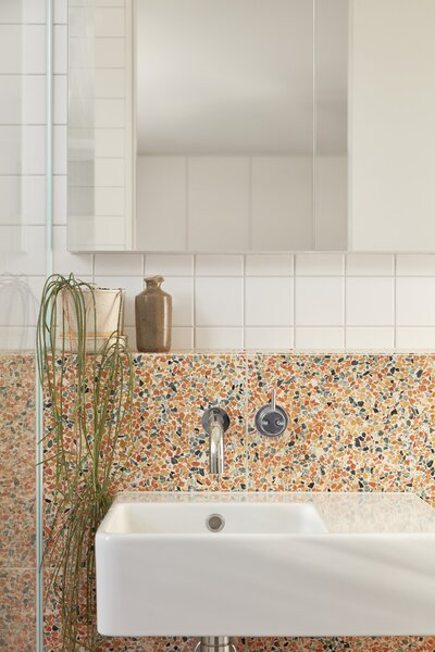 Classic Ceramics wall tiles are combined with Caroma Cube ceramic basins in the bathrooms.