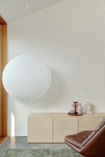 A large Pop and Scott paper lantern anchors a corner of the living room.