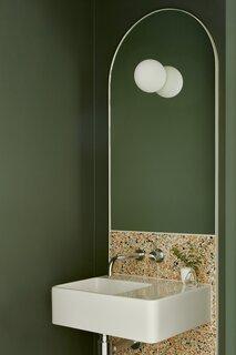 The powder room features Dulux Australia's Briar paint.