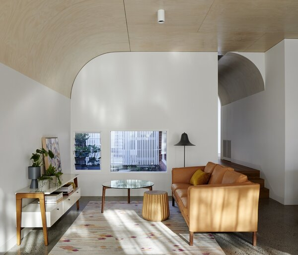 The curved ceiling was built from layered Austral Plywoods hoop pine plywood sourced from Queensland plantation forests. The flooring is blackbutt timber.