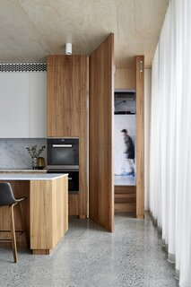A secret door to the right of the kitchen connects to the garage.
