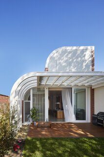 """The luscious double curves of Deco House, a gesture that navigates thorny planning guidelines, connects the project to the era of its namesake and introduces some Hollywood razzle dazzle to leafy Kew,"" say the architects."