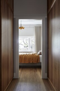 The architects moved the front door from behind the main bedroom to the side entry and converted the old entrance into a new walk-in wardrobe and en suite bedroom.