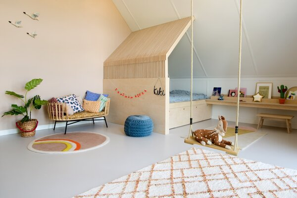 A large bed was deliberately chosen so that Kiki can grow into over it time. The vertically oriented plywood echoes the vertical lines of the hone's timber cladding.