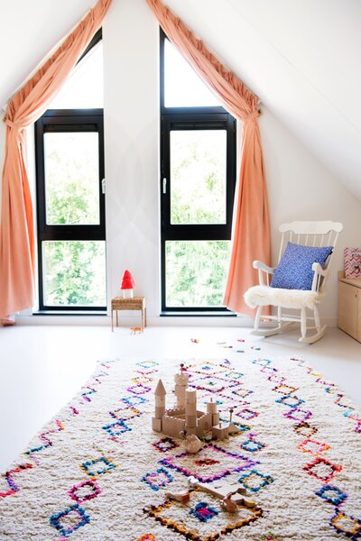Recyclable Senso resin gray floors and birch plywood surfaces tie all three kids' rooms together, which are located in the attic.