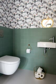 No Fred wallpaper adds a touch of whimsy in the children's bathroom.