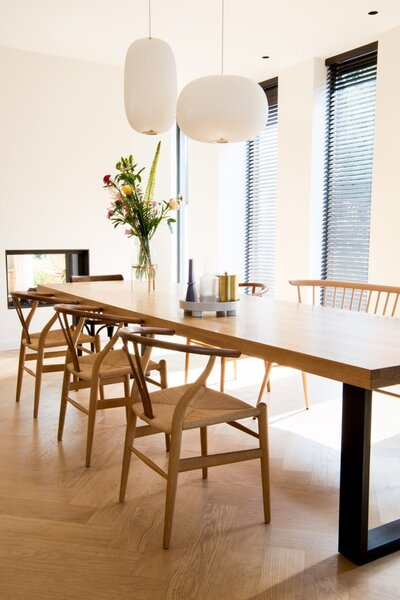 """A large wooden dining table was Eva's first priority in her furniture selection process. """"The table is now the heart of the home where we eat, play and enjoy dinners with each other."""""""