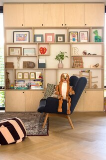 """A custom cabinet in the ground-floor playroom provides a variety of storage options. """"The biggest frustration of parents is that the toys are everywhere,"""" says Eva. """"I always try to create a kids' corner as well as some space for the parents. And of course enough storage options and a logical layout of the house will help to make a home child friendly."""""""