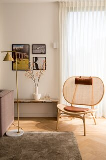 A NOR11 chair anchors a sunny corner.