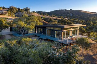 Elevated on an oak-studded hillside lot, the three-bedroom, three-bath Waterfall Residence overlooks spectacular views in three directions.