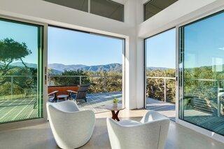 Lina swivel chairs overlook panoramic views.