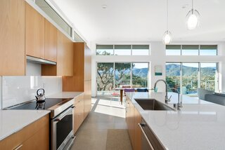The kitchen features custom cabinetry and Caesarstone countertops.
