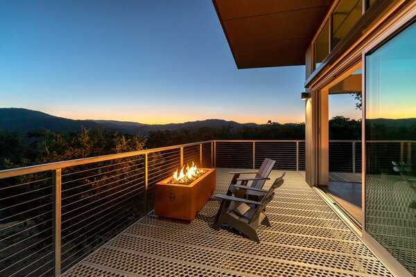 A fire pit and a pair of chairs on the west-facing deck are perfectly placed for sunset views.